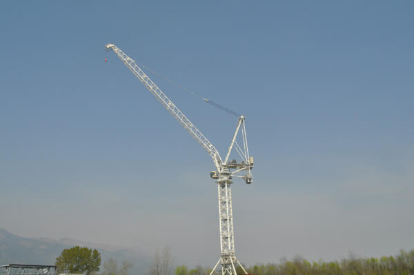 Terex CTL 1600-66 luffing jib tower crane on blue skies