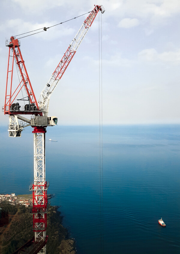 Terex CTL 650F-45 luffing jib tower crane on scenic job site