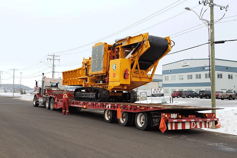 Horizontal Grinder on back of a Truck