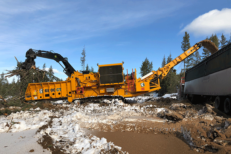 Horizontal Grinder Working in a Logging Application