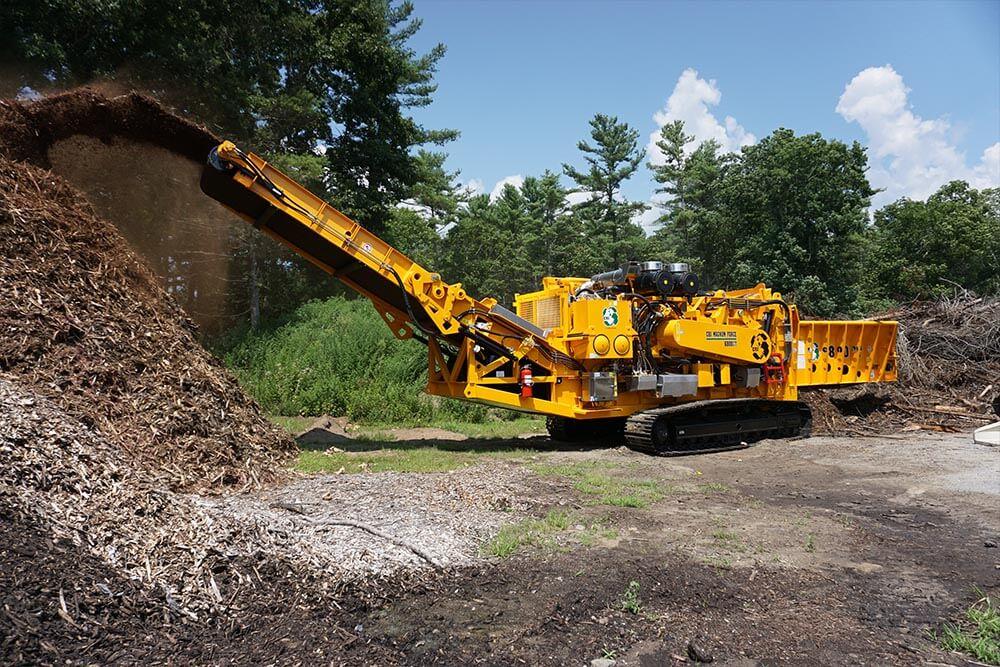 CBI 6800CT Horizontal Grinder grinding yard waste.