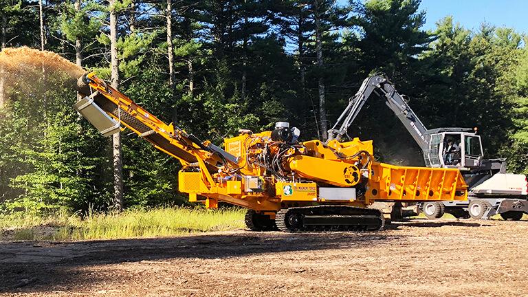 5800BT Horizontal Grinder grinding logs