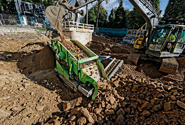 Compact Screening Machine being Fed by Excavator