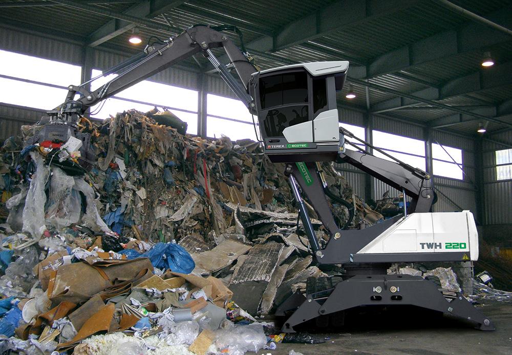 TWH 220 Waste Handler Lifting Rubbish